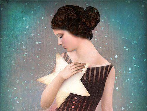 Kvinne holder stjerne