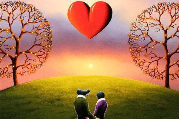 Kjærligheten endret livet mitt: Mann og kvinne ser på hjerte i himmelen