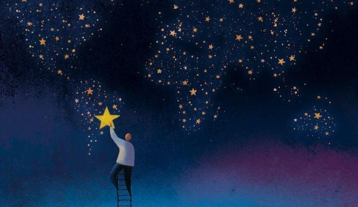 mann henger opp stjerner