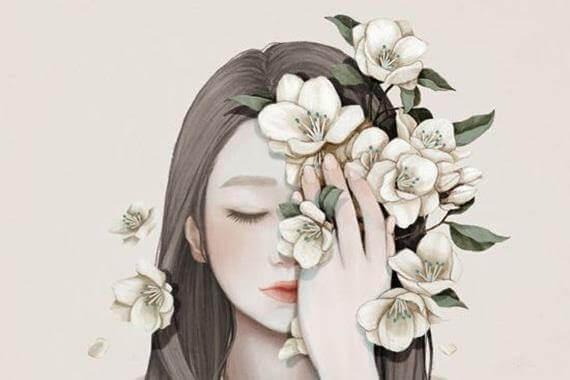 Kvinne med blomster i ansiktet