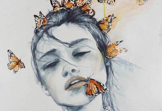 Kvinne med sommerfugler i ansiktet