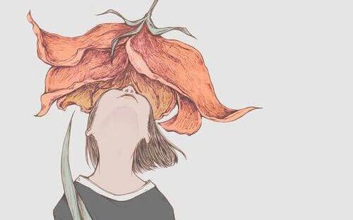 Jente lukter på blomst