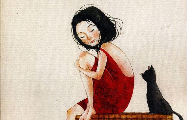 Kvinne i rød kjole sitter sammen med en svart katt