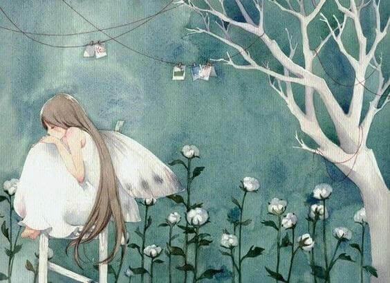 jente med vinger sitter i blomster