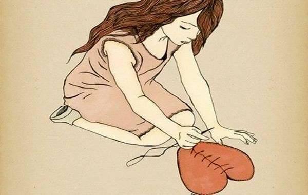 kvinne syr sammen hjerte