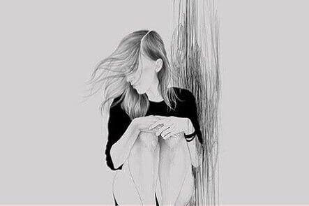 Jente sitter med vind i håret