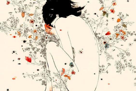 Kvinne i fosterstilling i blomster