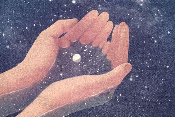 Hender holder universet