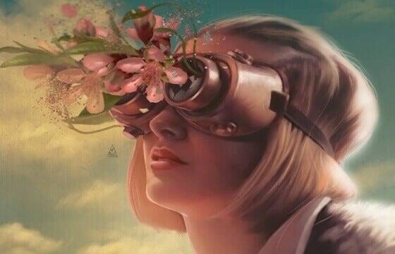 Kvinne ser på blomster