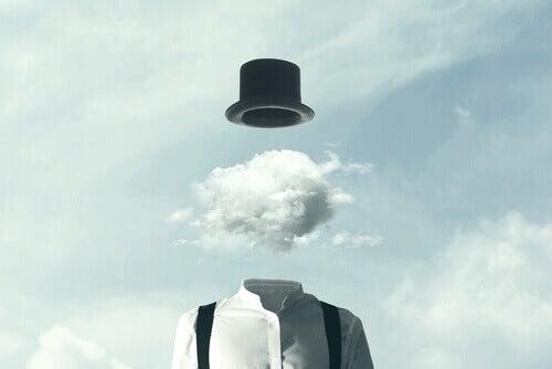 Mann med hatt med en sky som hode