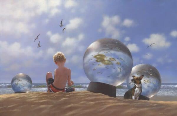 Barn og hund på stranden med fisk i snøkuler