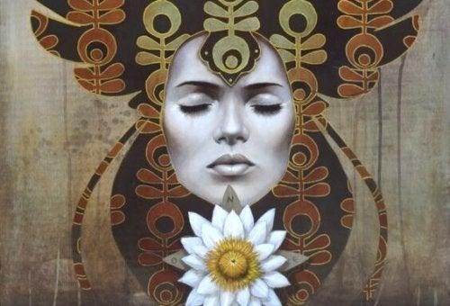 Åndelig kvinne med blomst