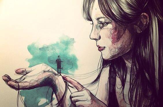 Kvinne med liten mann i hånden