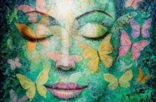 Grønt ansikt med sommerfugler
