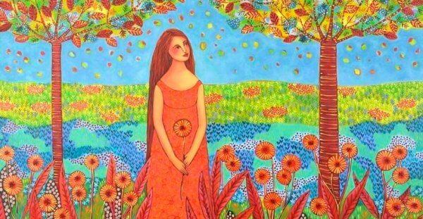 Kvinne i blomstereng