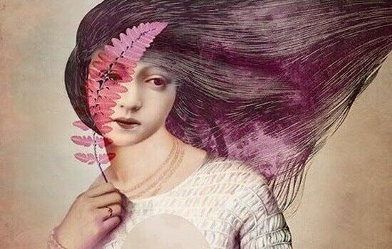 en rosa kvinne og et rosa blad