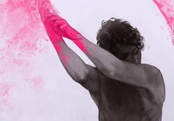 Mann med rosa hender