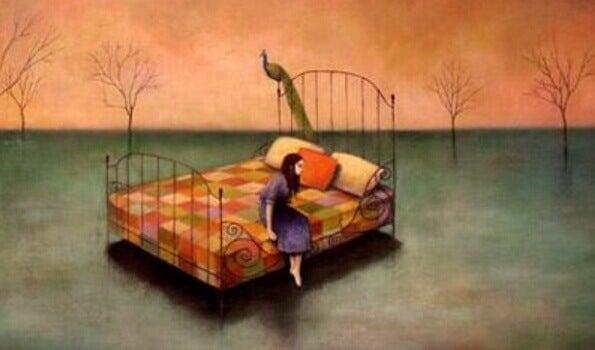 en sliten kvinne som sitter på kanten av sengen hennes