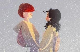 Mann og kvinne holder hender i snøvær og vet hva vi betyr