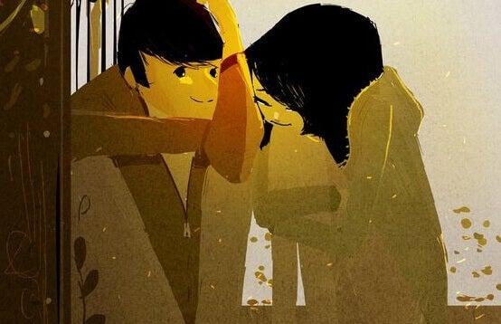 Et par sitter sammen og smiler