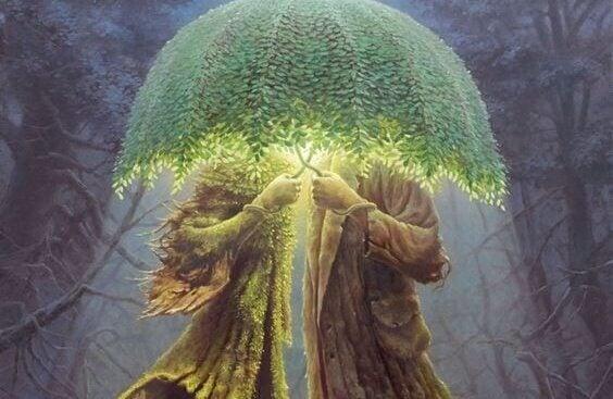 Steinpar med grønn paraply av blader