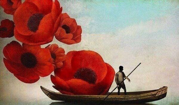 Mann seiler ved store blomster