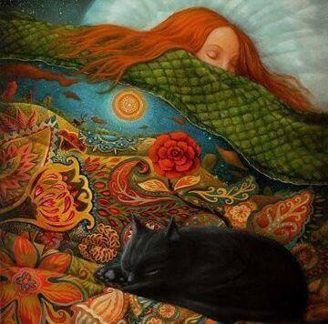 Kvinne og katt sover