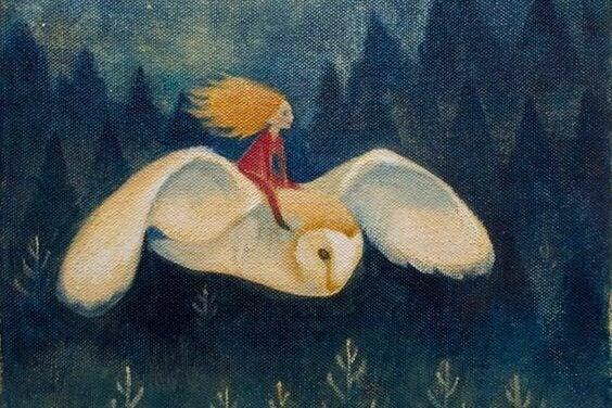 Kvinne flyr på ugle