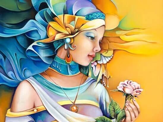 Nydelig kvinne holder en rose.