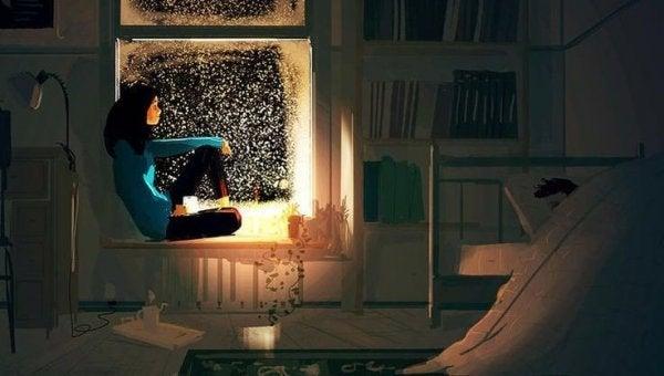 Kvinne sitter i vinduet om natten