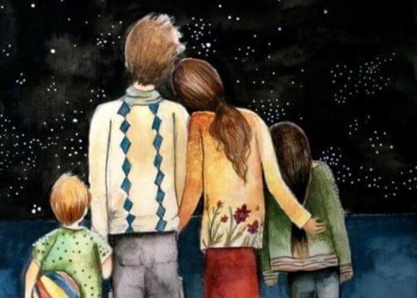 lykkelig familie ser på stjernene