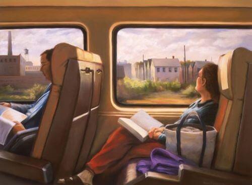 Kvinne leser på toget