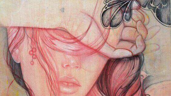 Kvinne som holder hånden foran øynene