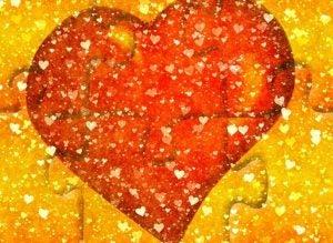 Et rødt hjerte på puslespill.