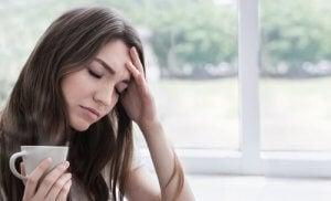 Kvinne med hodepine