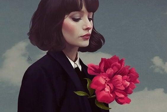 En kvinne i en drakt med rosa blomster.