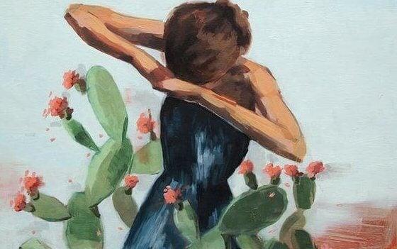 Kvinne fanget i kaktus