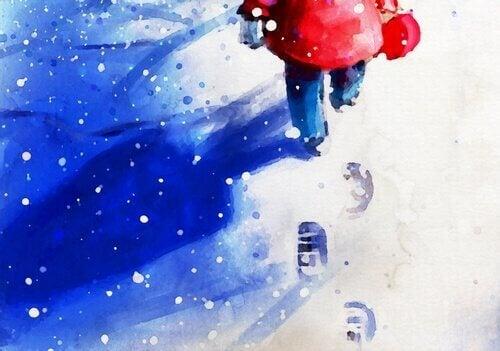 Gutt går i snøen