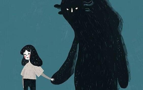 Jente holder hånden til monster