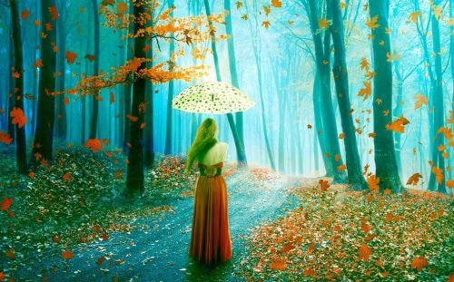 Jente med paraply i høstskog