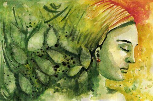 en kvinne med øynene lukket, i grønt