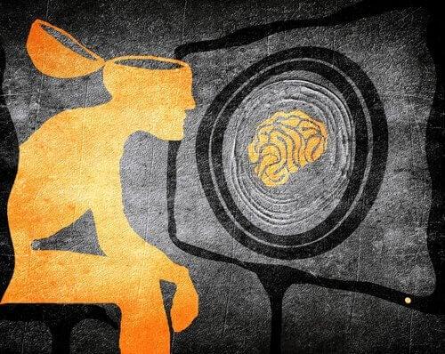 En figur blir manipulert av en digital skjerm, et bilde av mediamanipulasjon.