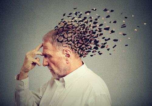 En person med et hode som oppløses i mange små biter