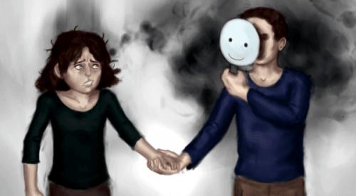 jente holder hånden til en med maske
