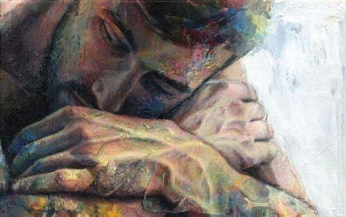 trist mann sover med hendene krysset