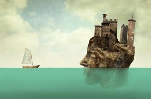 En båt og en øy formet som et hode