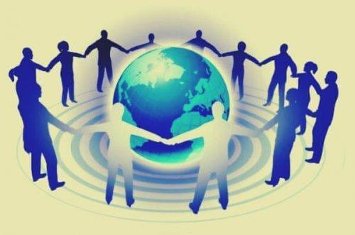 Virkningen av de tre grader av påvirkningsteori - mennesker holder hender rundt jordkloden