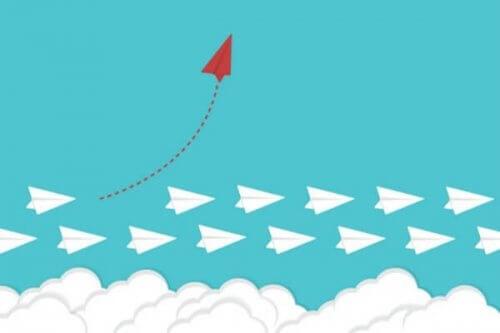 Rødt papirfly som representerer lyst til å forandre en vane