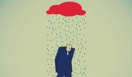 En mann under regnet