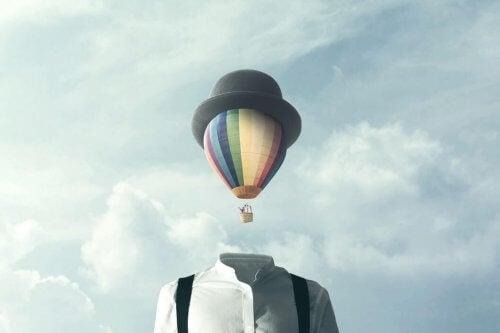 mann med luftballong som hode